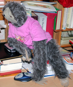 Large cuddly sloth sitting on the desk