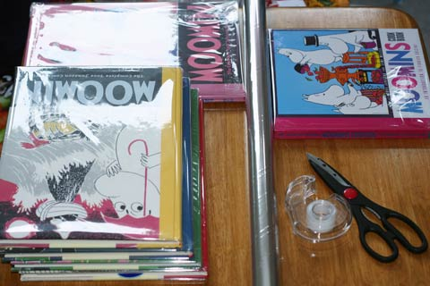 My Moomin comic strip books covered in clear book film.